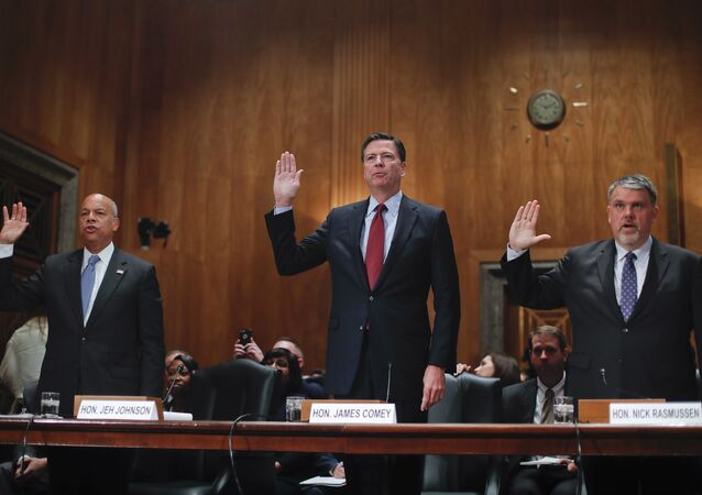 From left, Homeland Secretary Jeh Johnson, FBI Director James Comey, and Director of National Counterterrorism Center, Office of the National Intelligence, Nicholas J. Rasmussen are sworn-in on Capitol Hill in Washington prior to testifying before the Senate Homeland Security and Governmental Affairs Committee hearing on on terror threats