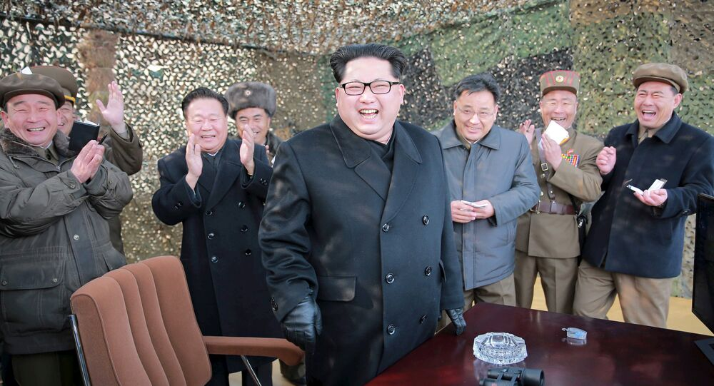 North Korean leader Kim Jung Un smiles after a successful test of a new rocket launch system.