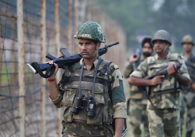 Indian Border Security Force soldiers patrol the India-Pakistan border area.