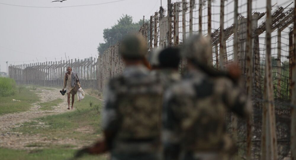 Indian Border Security Force soldiers patrol the India-Pakistan border area at Ranbir Singh Pura, about 35 kilometers (22 miles) from Jammu, India, Saturday, Sept. 24, 2016
