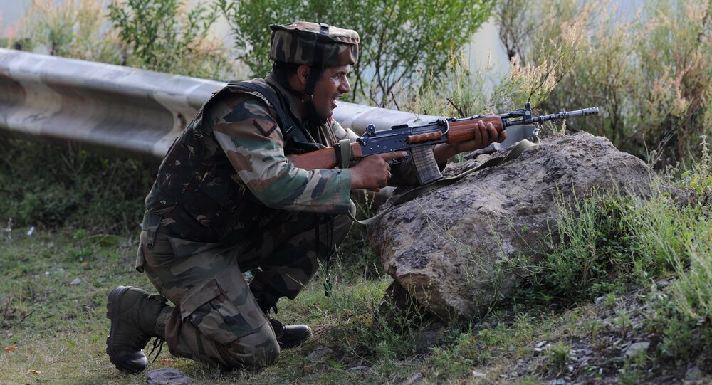 An Indian army soldier takes up a position near the site of a gunbattle between Indian army soldiers and rebels inside an army brigade headquarters near the border with Pakistan, known as the Line of Control (LoC), in Uri on September 18, 2016