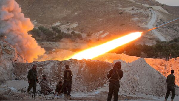Free Syrian Army fighters launch a Grad rocket from Halfaya town in Hama province (File) - Sputnik International