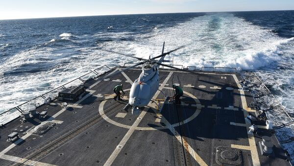 The MQ-8C Fire Scout sits on the deck of the guided-missile destroyer, USS Jason Dunham (DDG 109) (File) - Sputnik International