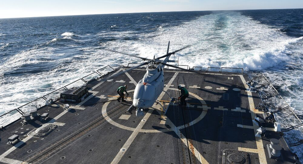 The MQ-8C Fire Scout sits on the deck of the guided-missile destroyer, USS Jason Dunham (DDG 109) (File)