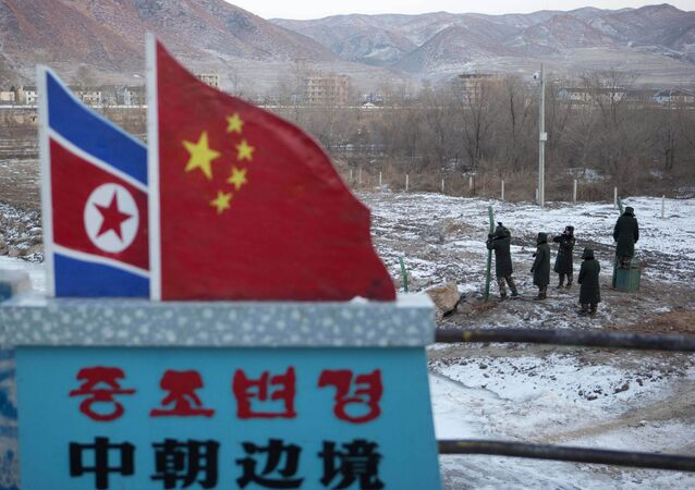 North Korean and Chinese national flags (File)