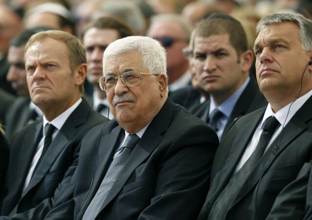 Palestinian president Mahmud Abbas (C) sits alongside European Council President Donald Tusk (L) and Romanian President Klaus Iohannis at Jerusalem's Mount Herzl national cemetery during the funeral of former Israeli president Shimon Peres on September 30, 2016