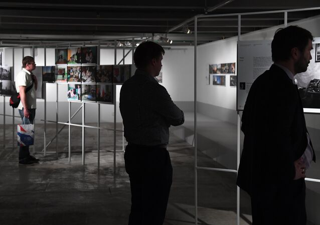 Visitors at the exhibition by winners of the Andrei Stenin International Press Photo Contest