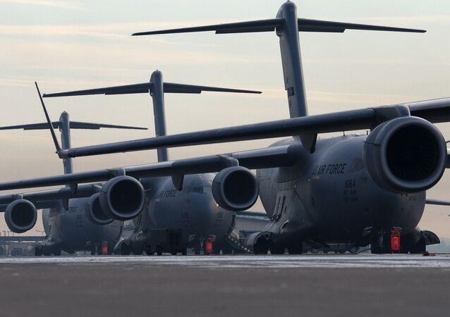 U.S. Air Force C-17 Globemaster III's sit stacked up on ramp 5 ready for the days mission, Ramstein Air Base, Germany