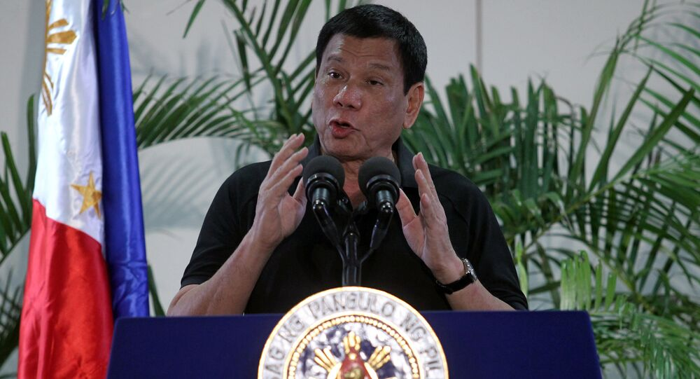 Philippines President Rodrigo Duterte gestures during a news conference upon his arrival from a state visit in Vietnam at the International Airport in Davao city, Philippines September 30, 2016.