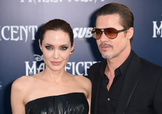 Angelina Jolie and Brad Pitt arrive for the world premiere of Disney's Maleficent, May 28, 2014, at El Capitan Theatre in Hollywood, California.