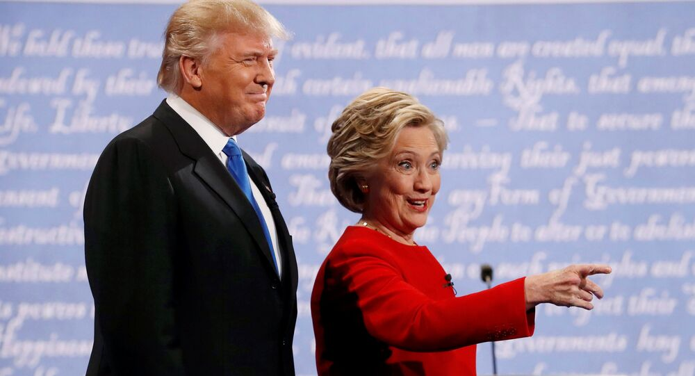 Republican US presidential nominee Donald Trump and Democratic U.S. presidential nominee Hillary Clinton look on at the start of their first presidential debate at Hofstra University in Hempstead, New York, US, September 26, 2016.