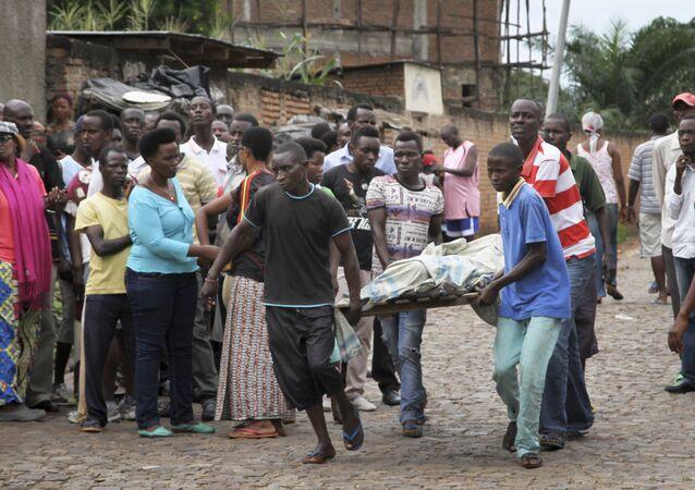 Men carry away a dead body in the Nyakabiga neighborhood of Bujumbura, Burundi (File)