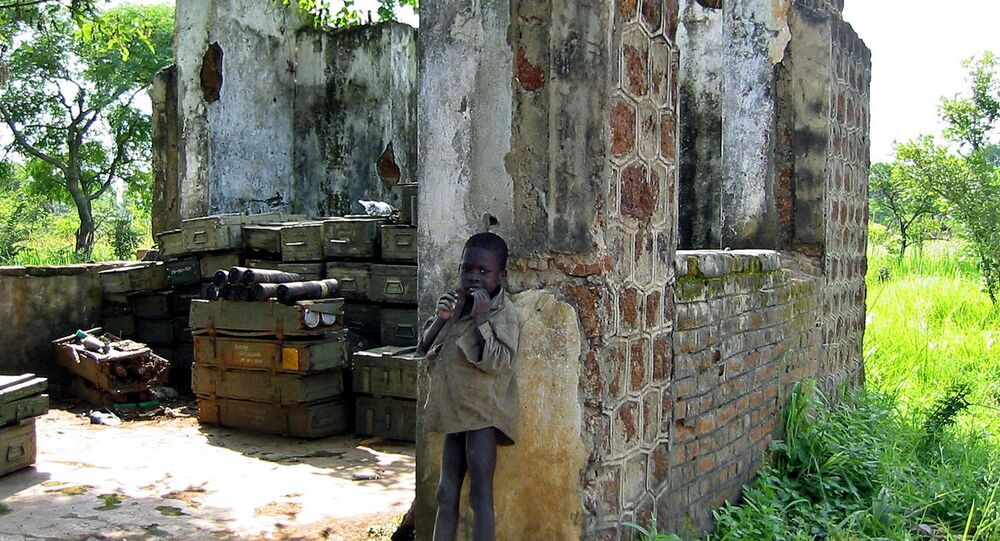 A Sudanese child is pictured  in front of a partially-destroyed house used to store ammunitions in Yei, south Sudan, where the Sudan People's Liberation Army has its headquarters (File)