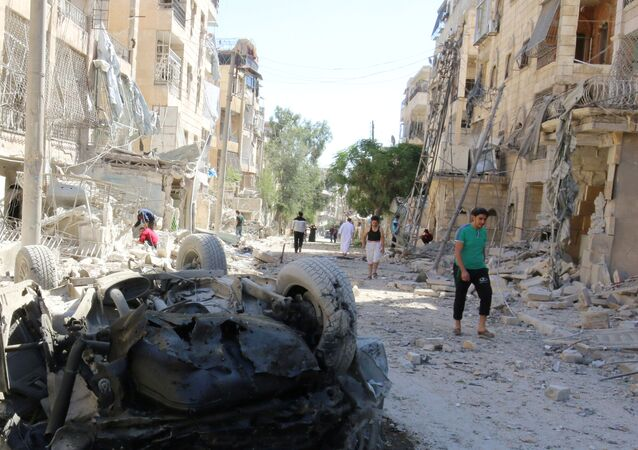People inspect the damage at a site hit overnight by an air strike in the rebel-held area of Seif al-Dawla neighbourhood of Aleppo, Syria, September 30, 2016