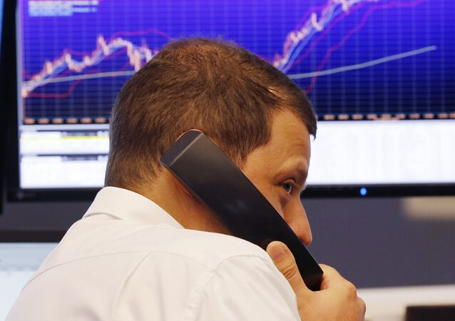 A trader makes a telephone call