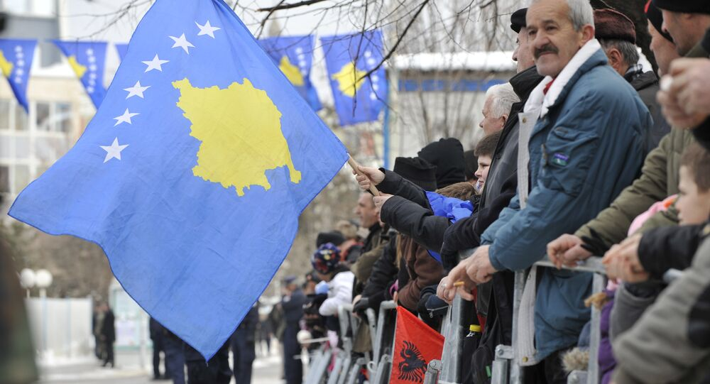 Kosovo Albanians wave the Kosovo flag during a celebration marking the 4th anniversary of the Kosovo's declaration of independence in Pristina on February 17, 2012