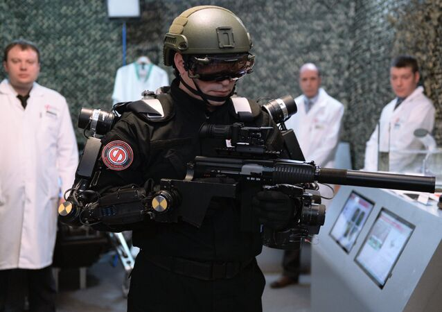 The Advanced Research Fund's employee demonstrating an exoskeleton at the Federation Council in Moscow