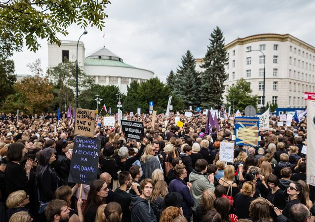 People attend the anti-government, pro-abortion demonstration in front of Polish Pariament in Warsaw, Poland on October 1, 2016