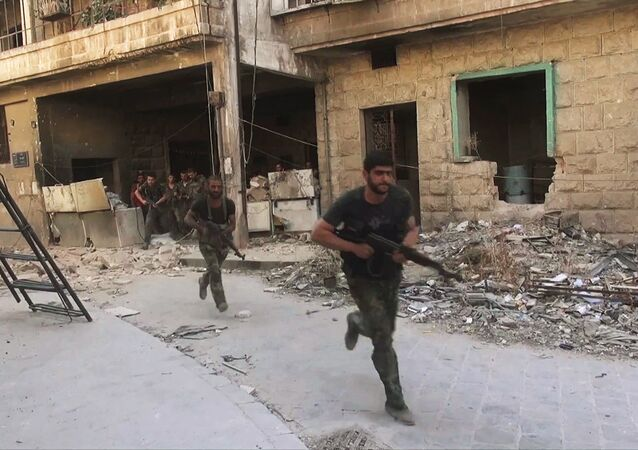 Syrian army soldiers during an assault on Jabhat al-Nusra fighters in Aleepos eastern district of Suleiman al-Halabi