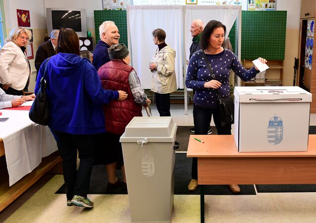 Voters are pictured at a polling station in Budapest