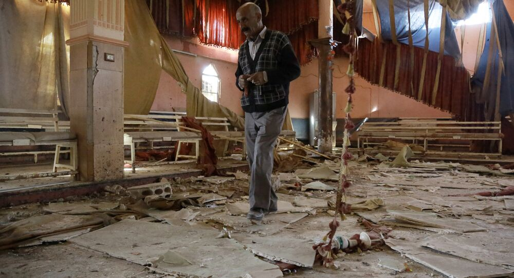 A man inspects the damage at a wedding hall a day after a suicide attack targeted a Kurdish wedding party in the village of Tall Tawil in the Syrian Hasakeh province