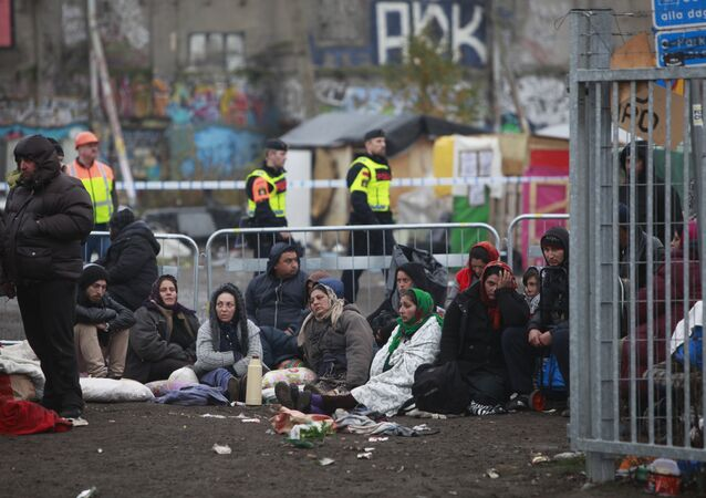 Migrants sit on the ground before leaving an illegal camp set up in Malmo (file)