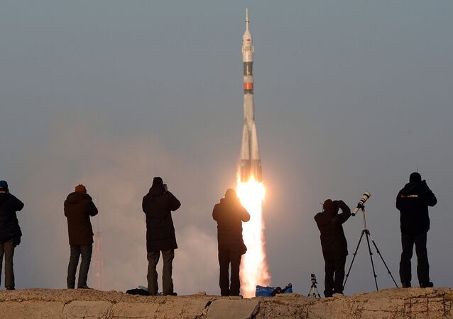 The launch of a Soyuz-FG rocket with the Soyuz TMA-19M manned spacecraft from the Baikonur Space Center.