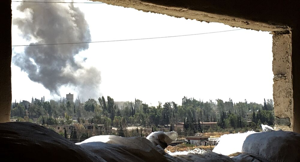 Smoke over Ramuse district of southern Aleppo. (File)