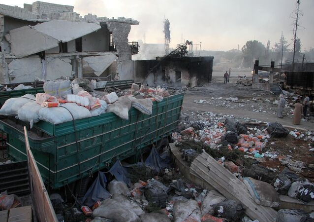 aid strewn across the floor in the town of Orum al-Kubra on the western outskirts of the northern Syrian city of Aleppo, the morning after a convoy delivering aid was hit by a deadly air strike.