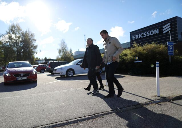 Ericsson workers walk outside the Ericsson factory in Boras , Sweden, October 4 , 2016