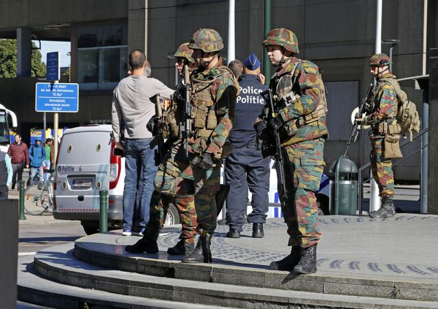 Police and army personnel stand guard during a bomb alert outside the Brussels-North (Gare du Nord - Noordstation) train station in Brussels