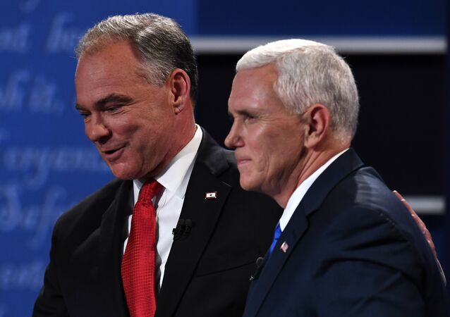 Democratic candidate for Vice President Tim Kaine (L) shakes hands with Republican candidate for Vice President Mike Pence after the vice presidential debate at Longwood University in Farmville, Virginia on October 4, 2016.