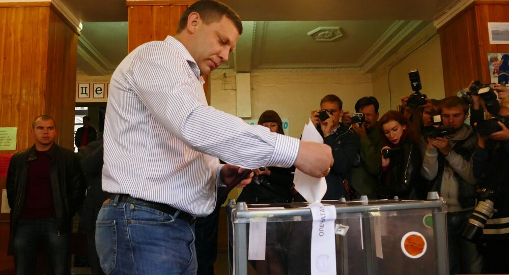 Head of the Donetsk People's Republic Alexander Zakharchenko (centre) after voting at Station No. 34 of Voroshilovsky District, Donetsk