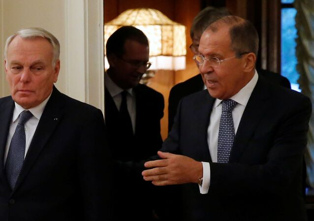 Russian Foreign Minister Sergei Lavrov (R) and French Foreign Minister Jean-Marc Ayrault enter a hall during their meeting in Moscow, Russia, October 6, 2016.
