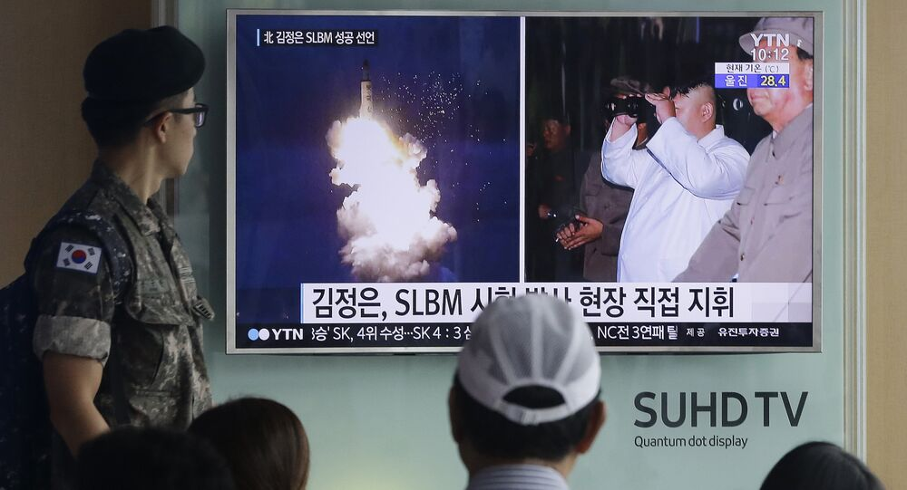 South Korean army soldier watches a TV news program showing images published in North Korea's Rodong Sinmun newspaper of North Korea's ballistic missile believed to have been launched from underwater and North Korean leader Kim Jong-un, at Seoul Railway station in Seoul, South Korea (File)
