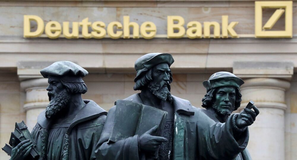 A statue is pictured next to the logo of Germany's Deutsche Bank in Frankfurt, Germany, September 30, 2016