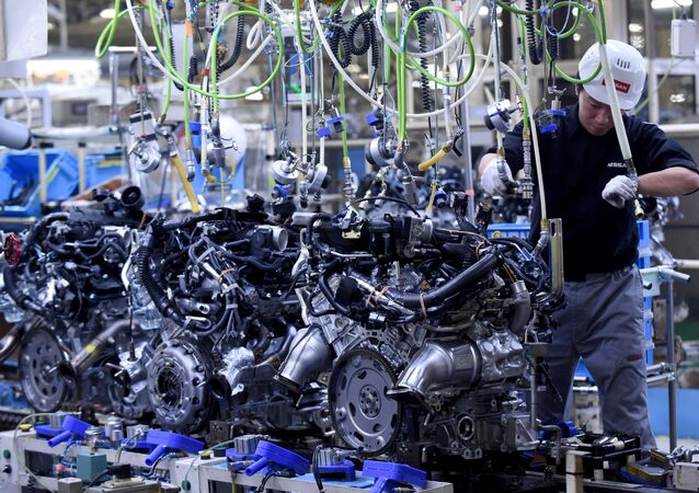 (FILES) This file photo taken on April 5, 2016 shows an employee working at the main assembly line of V6 engines at the Iwaki Plant of Japan's Nissan Motor in Iwaki, Fukushima prefecture