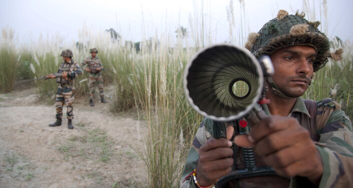 Indian army soldiers patrol near the highly militarized Line of Control dividing Kashmir between India and Pakistan, in Pallanwal sector, about 75 kilometers from Jammu, India, Tuesday, Oct. 4, 2016