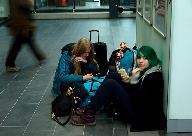 Two cell phone subscribers waiting. Sweden