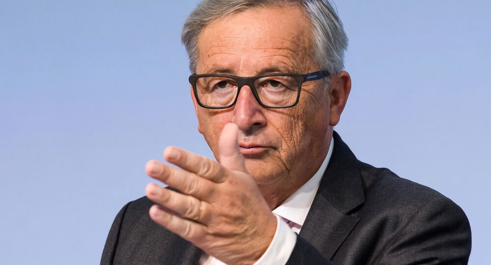 European Commission President Jean-Claude Juncker gestures during a plenary session of European Economic and Social Committee at the EU Charlemagne building in Brussels on Thursday, Sept. 22, 2016