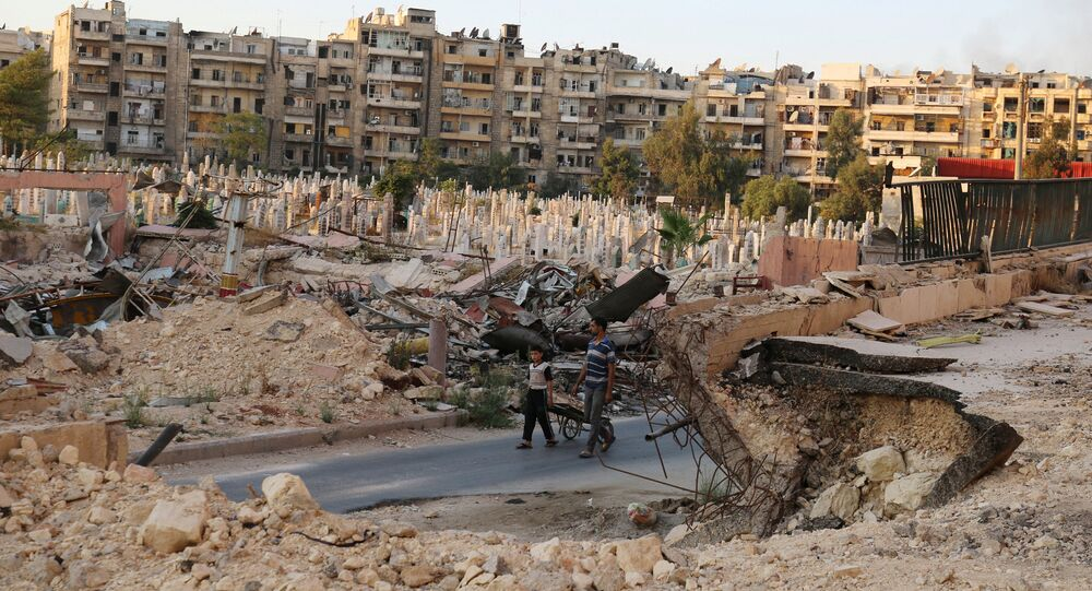 People walk near an over-crowded graveyard in the rebel held al-Shaar neighbourhood of Aleppo, Syria October 6, 2016