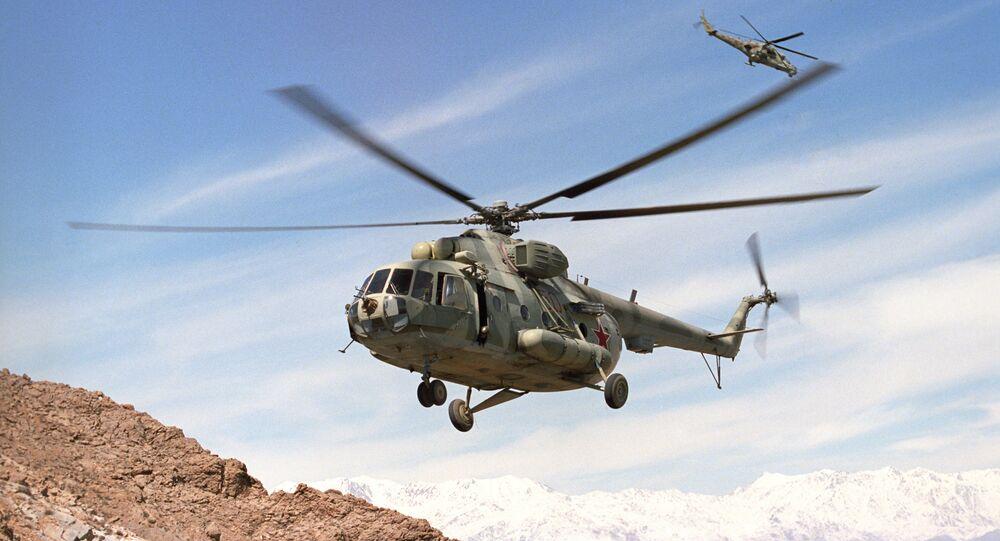 Mi-8, Mi-24 helicopters in flight  near Kabul, Afghanistan (File)