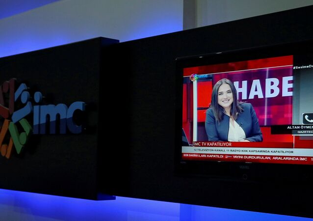 News anchor Banu Guven is seen on a screen during a news broadcast at a studio of IMC TV, a news broadcaster slated for closure, in Istanbul, Turkey, September 30, 2016.