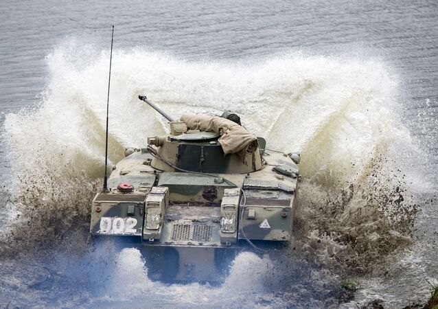 A BMD-2 airborne fighting vehicle crosses a water obstacle during a command & headquarters exercise involving the 106th Guards Airborne Division in Russia's Ryazan Region