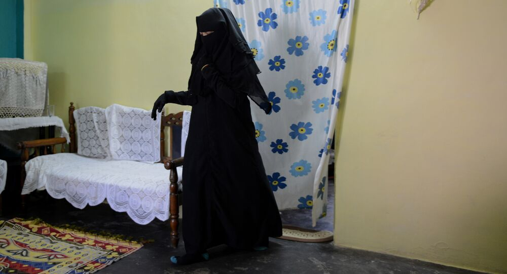 In this photograph taken on April 28, 2016, Shaista Ali, 26, at her house in Bhopal. Only three words were scrawled on the letter from her husband and posted to her parent's home in central India, but they were enough to shatter Sadaf Mehmood's life. Using an ancient and controversial Islamic practice, Mehmood's husband wrote talaq, talaq, talaq or I divorce you three times in Arabic, instantly ending his marriage of five years