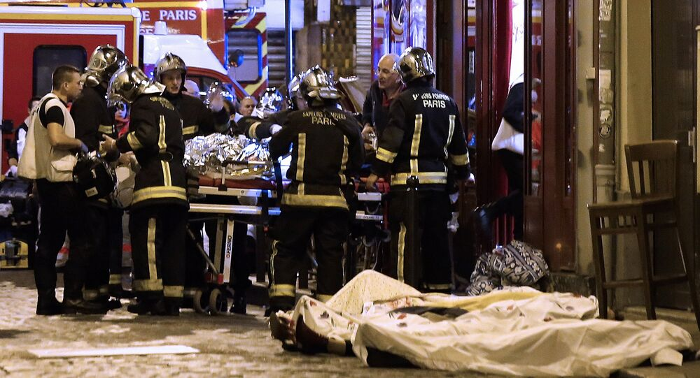 In this November 13, 2015 file photo, rescue workers tend to victims of the terrorist attacks in the 10th district of Paris