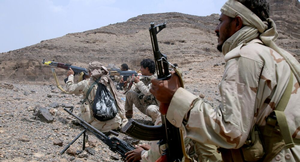 Yemeni tribesman from the Popular Resistance Committees, supporting forces loyal to Yemen's Saudi-backed President, aim their weapons as they hold a position during fighting against Shiite Huthi rebels and their allies on September 7, 2016, in the Hilan mountains, west of Marib city