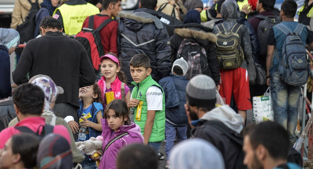 Migrants arrive at the railway station in Munich, southern Germany, on September 12, 2015