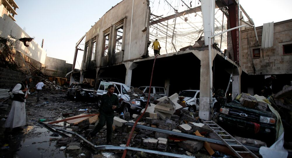 People stand at the site of an airstrike which witnesses said was by Saudi-led coalition aircraft on mourners at a hall where a wake for the father of Jalal al-Roweishan, the interior minister in the Houthi-dominated Yemeni government, was being held, in Sanaa, Yemen October 8, 2016