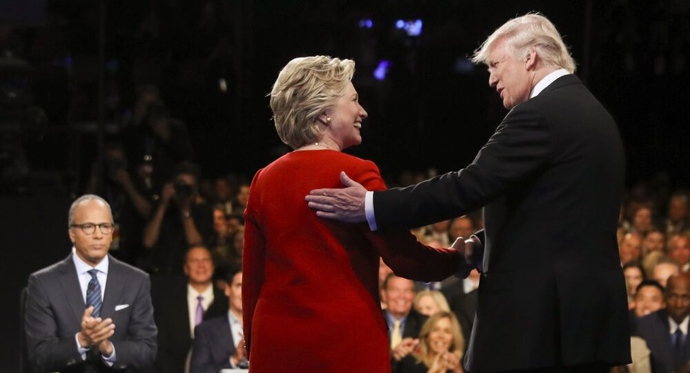 In this September 26, 2016 file photo, Democratic presidential nominee Hillary Clinton and Republican presidential nominee Donald Trump shake hands during the presidential debate at Hofstra University in Hempstead, New York.